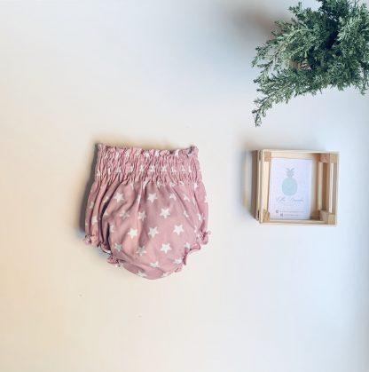 Cubrepañal de estrellas rosa