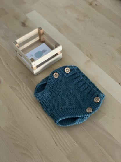 cubrepañal de lana verde